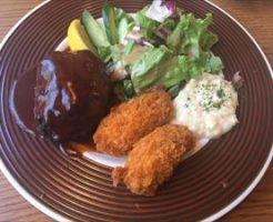 北海道観光レンタカー北海道八雲町産の豚肉を使用した ハンバーグと広島産のカキフライのセット